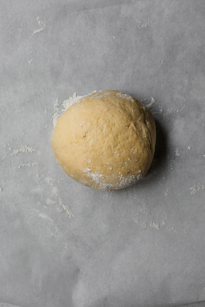 The kneaded bugnes dough shaped into a ball