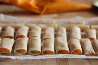 90° of the filled cannelloni filled with butternut squash filling on a piece of parchment paper