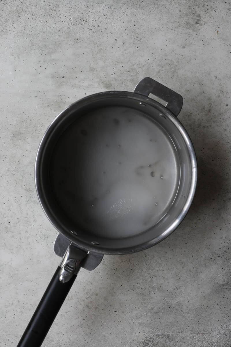 A pan with sugar, glucose, and water