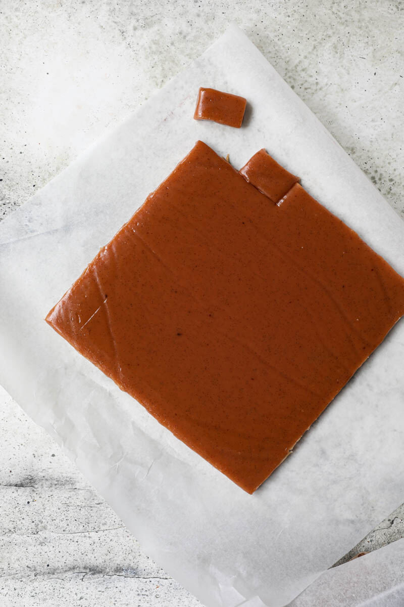 Sliced caramel candy on a piece of parchment paper