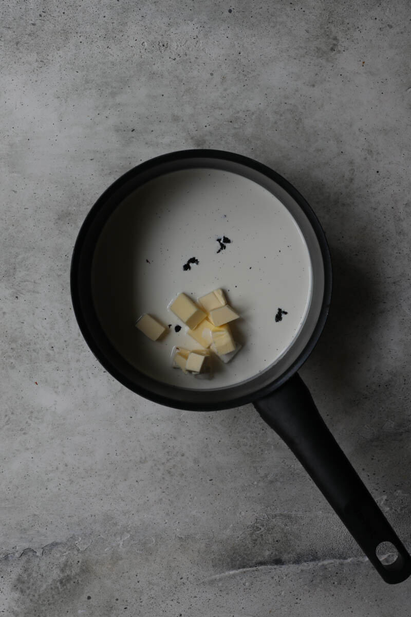 A pan with cream, butter, and vanilla bean