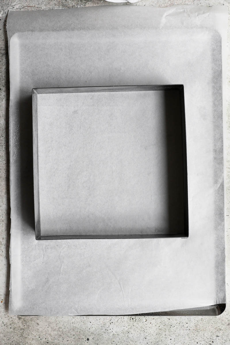 Lined square pan on a baking tray