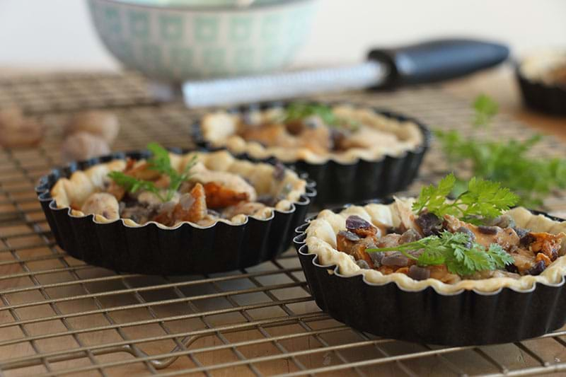 90° shot of the filled chicken and mushroom tartelettes before baking