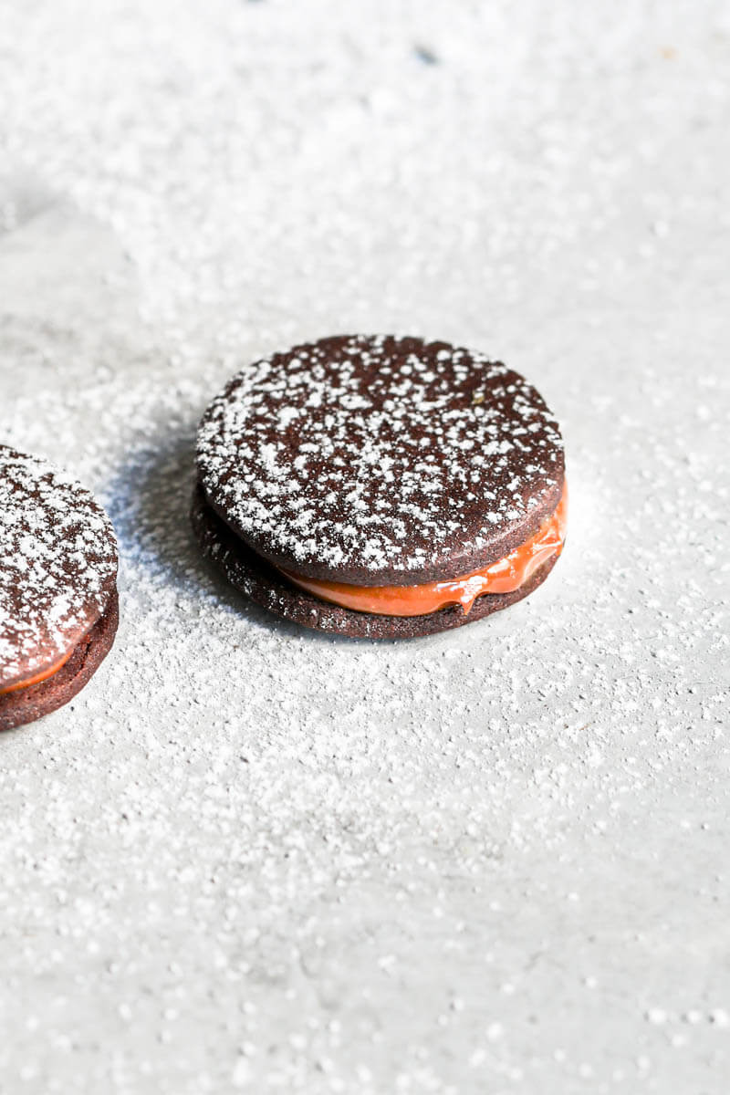 45° shot of one chocolate alfajor filled with dulce de leche