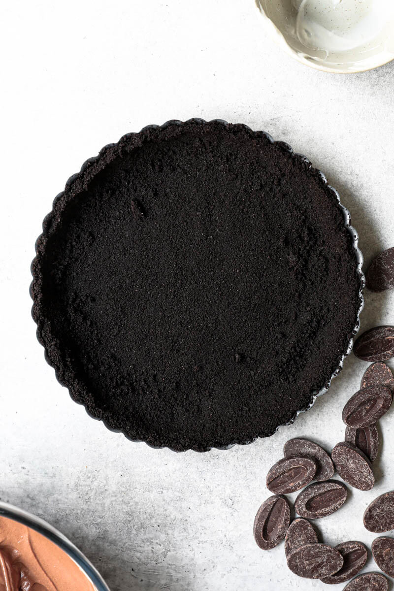 Overhead shot of the pie tin lined with the oreo pie crust