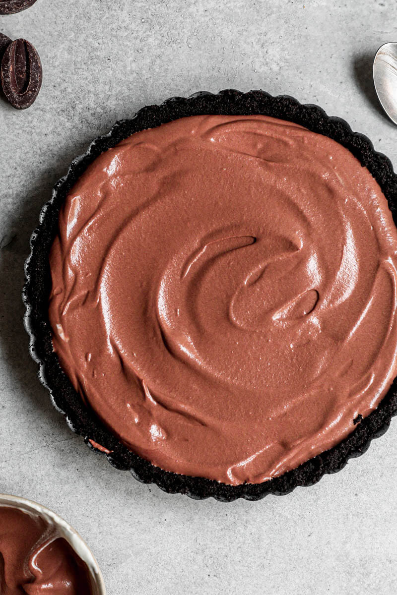 Overhead shot of the chocolate mousse pie filled with the chocolate mousse ready to be refrigerated