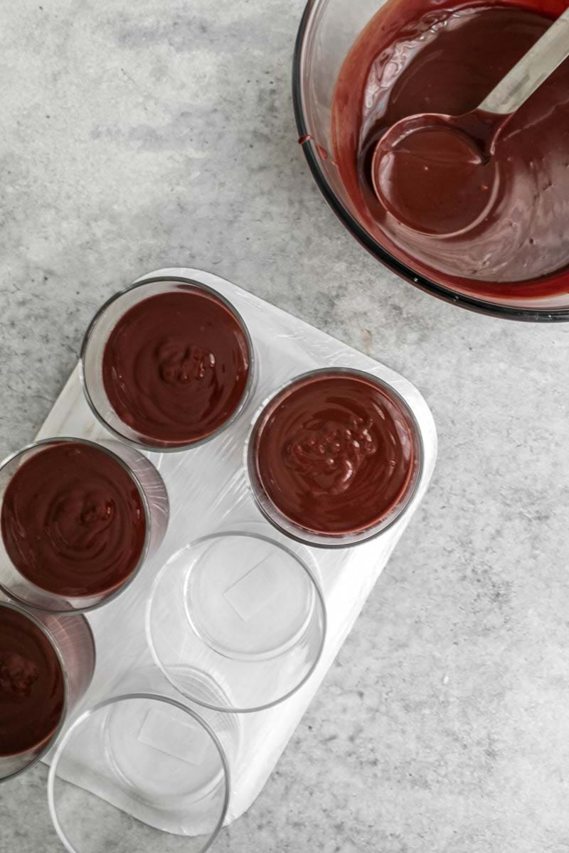 Fill in the jars with the chocolate crème using a ladle