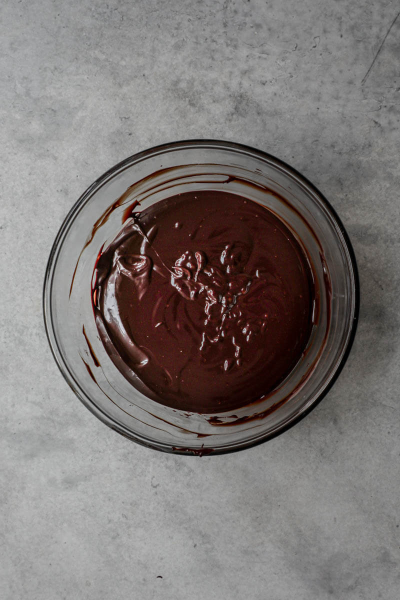 Dark chocolate ganache in a glass bowl