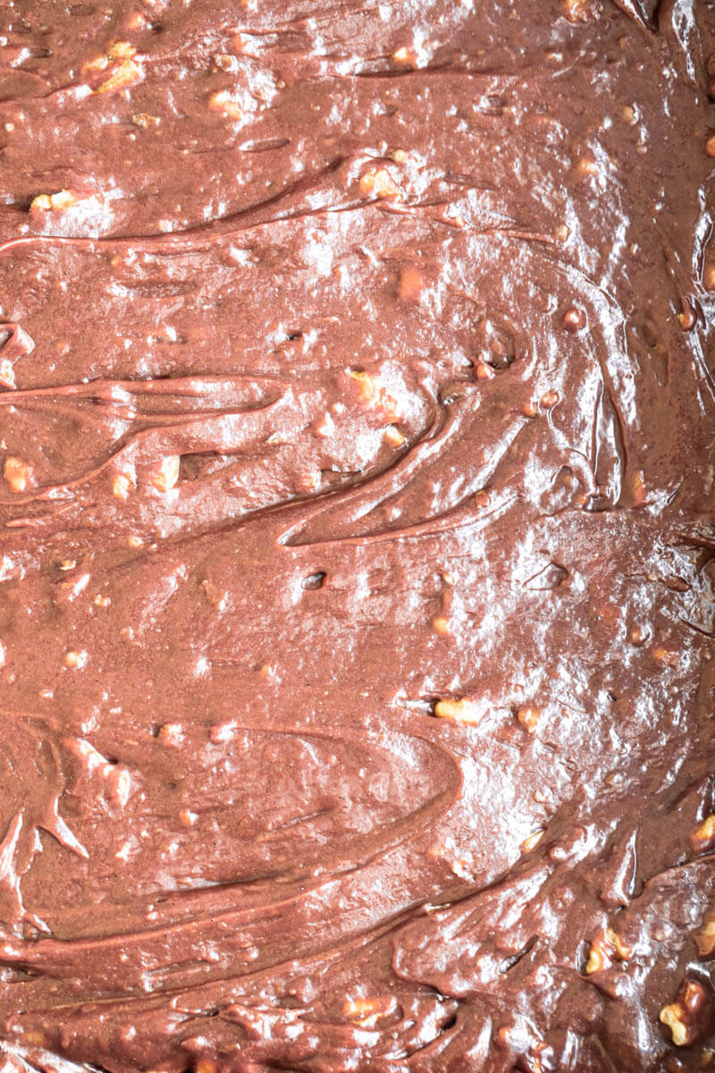 Overhead macro shot of the brownie batter in the baking tray