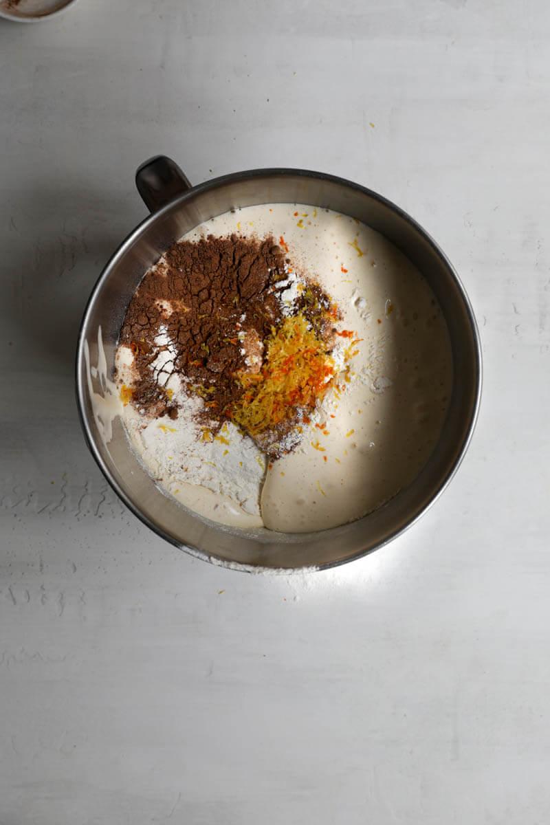 A bowl with the egg, sugar mixture plus flour, spices and citrus zests