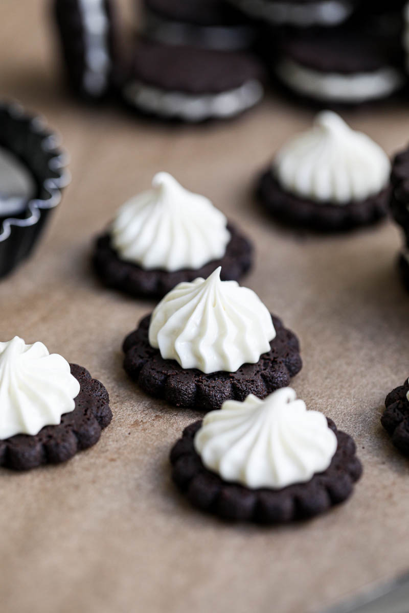 Closeup of Oreo cookies filled with a kiss of white chocolate ganache.