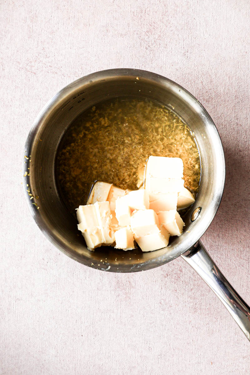 Making the lemon cream for the square lemon bars: a small pan with lemon juice, lemon zest and butter.