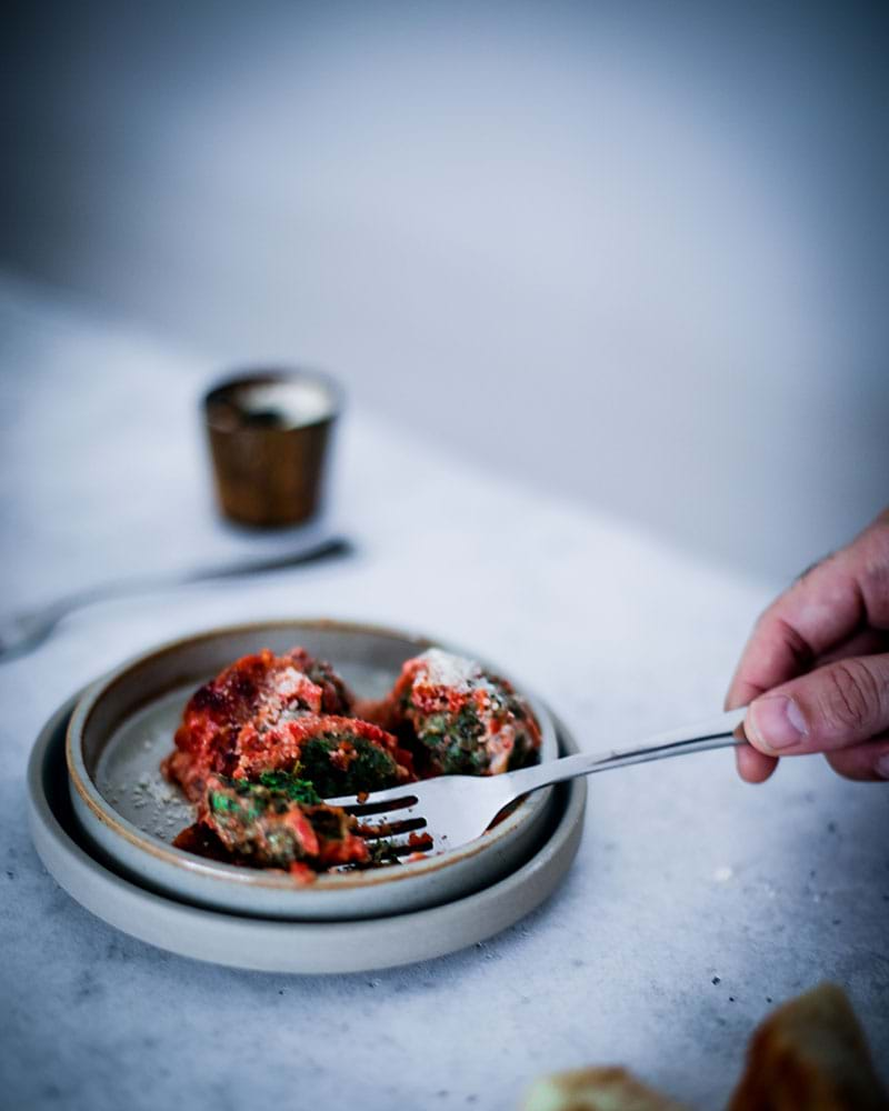 45° shot of a fork digging into the spinach malfatti