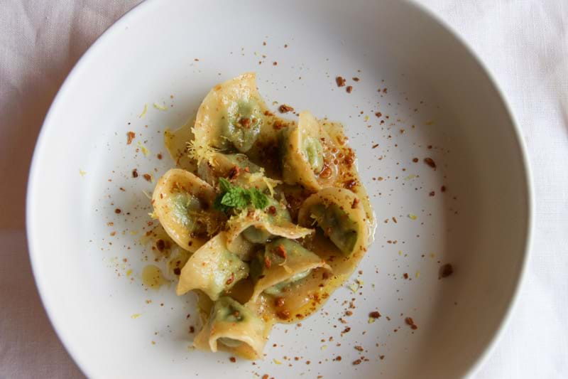 Overhead shot of the ricotta, peas & mint tortellini on a plate