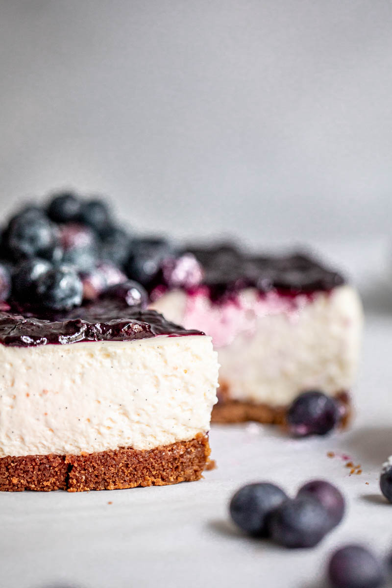 The sliced fluffy no bake vanilla blueberry cheesecake as seen from the side.