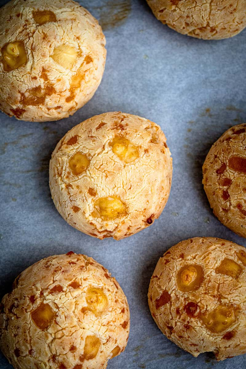 Overhead shot of pao de queijo on the baking tray with parchment paper