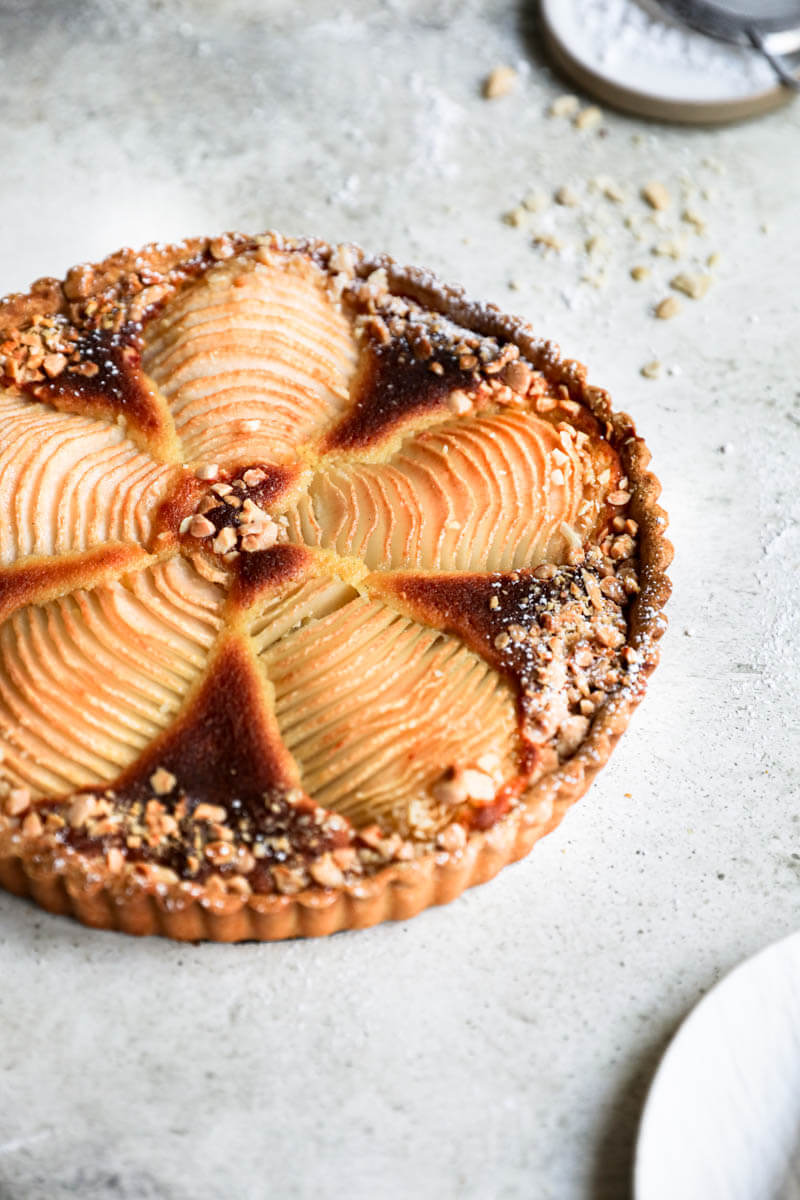45° shot of the baked pear frangipane tart with syrup