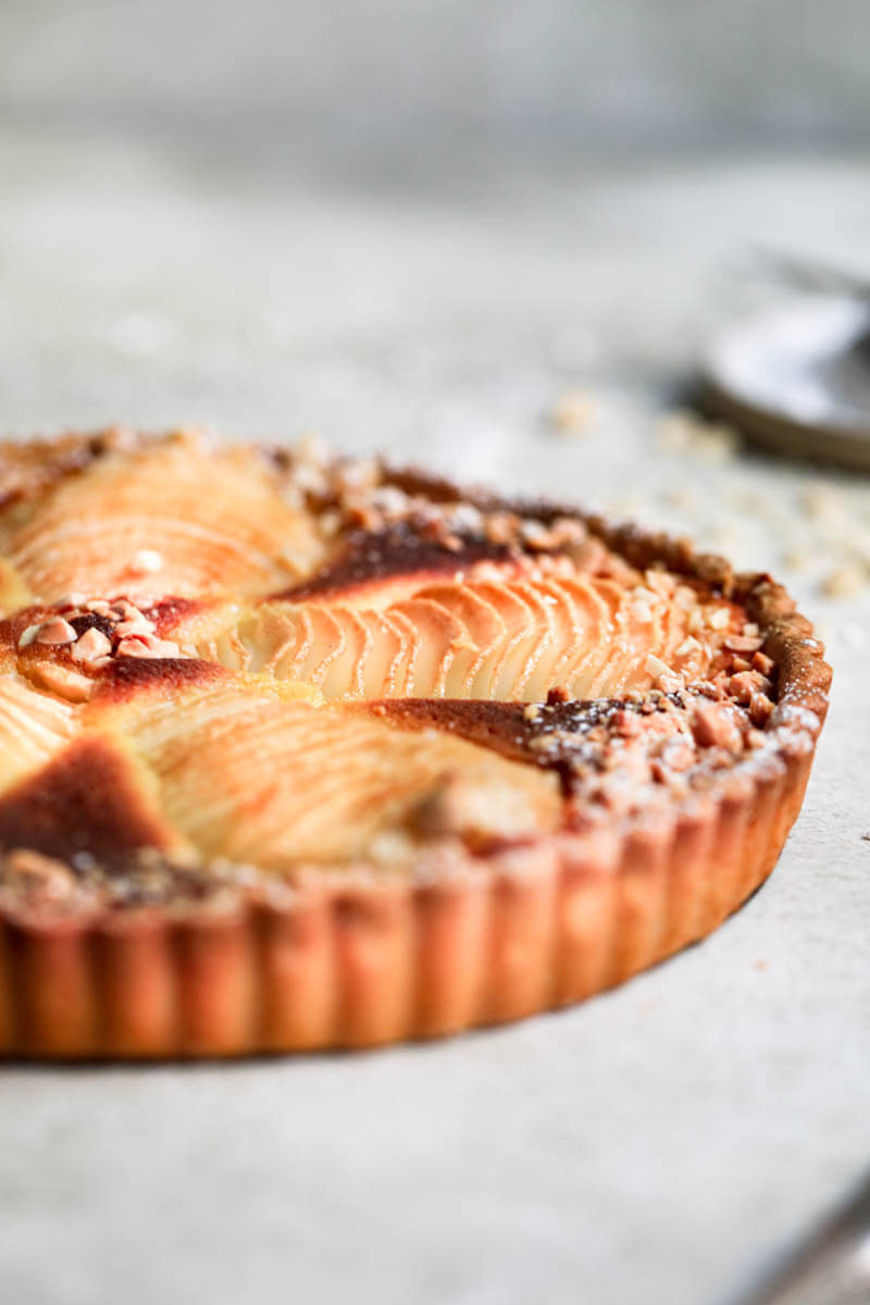 90° shot of half the baked pear frangipane tart