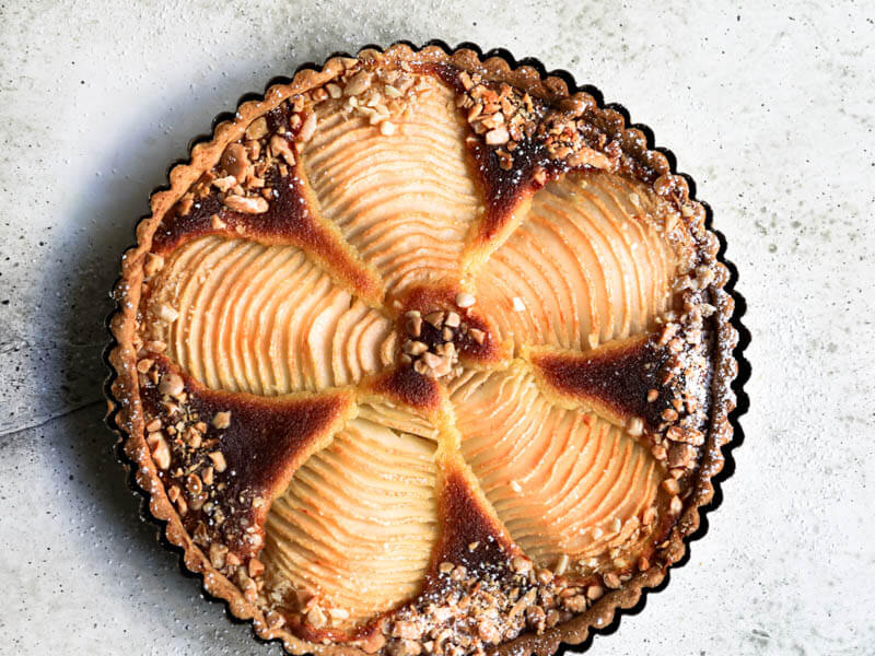 Overhead shot of the pear frangipane tart in the tart tin