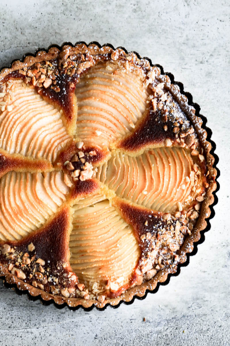 Overhead shot of the baked pear frangipane tart in the tart tin