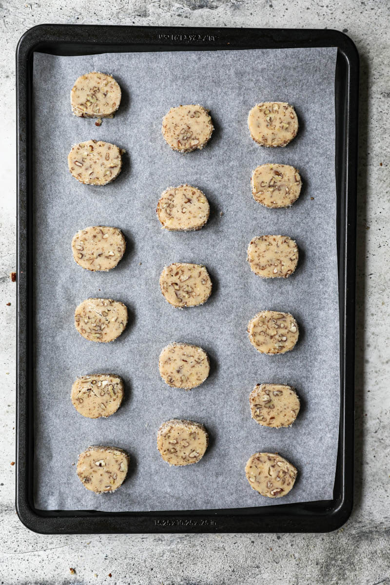 Cookies arranged on a baking tray lined with parchment paper