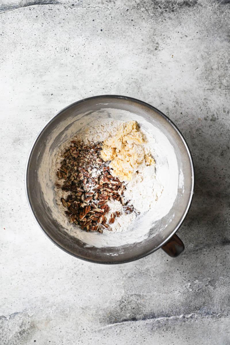 A bowl with the dough plus pecans plus the rest of the flour