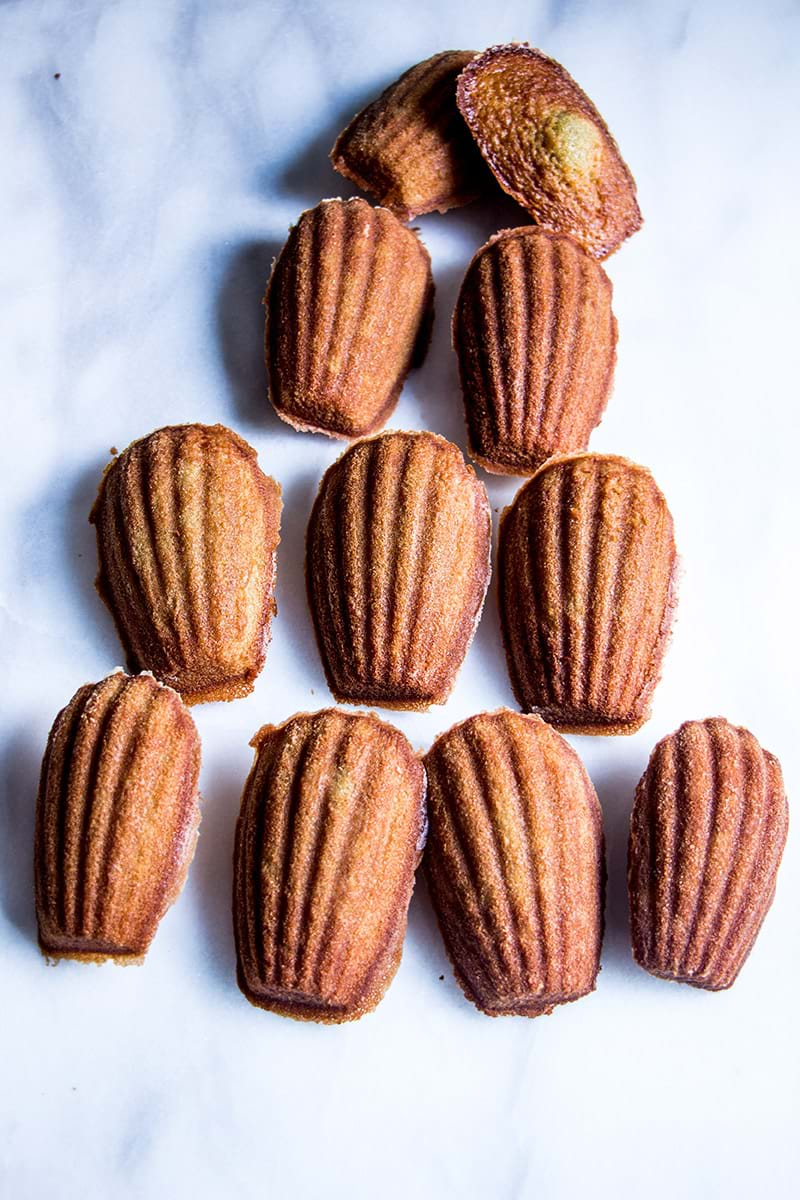 Overhead shot of pistachio madeleines disposed in a pyramid shape