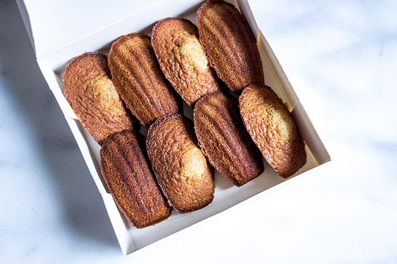 Pistachio madeleines inside a white box