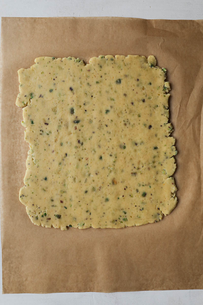 The rolled pistachio shortbread crust for the tartlets.