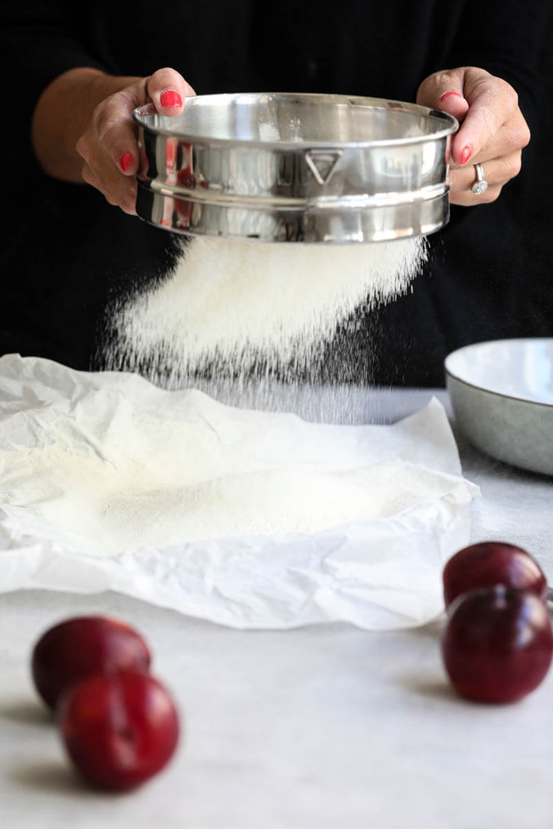 Plums and sifting flour