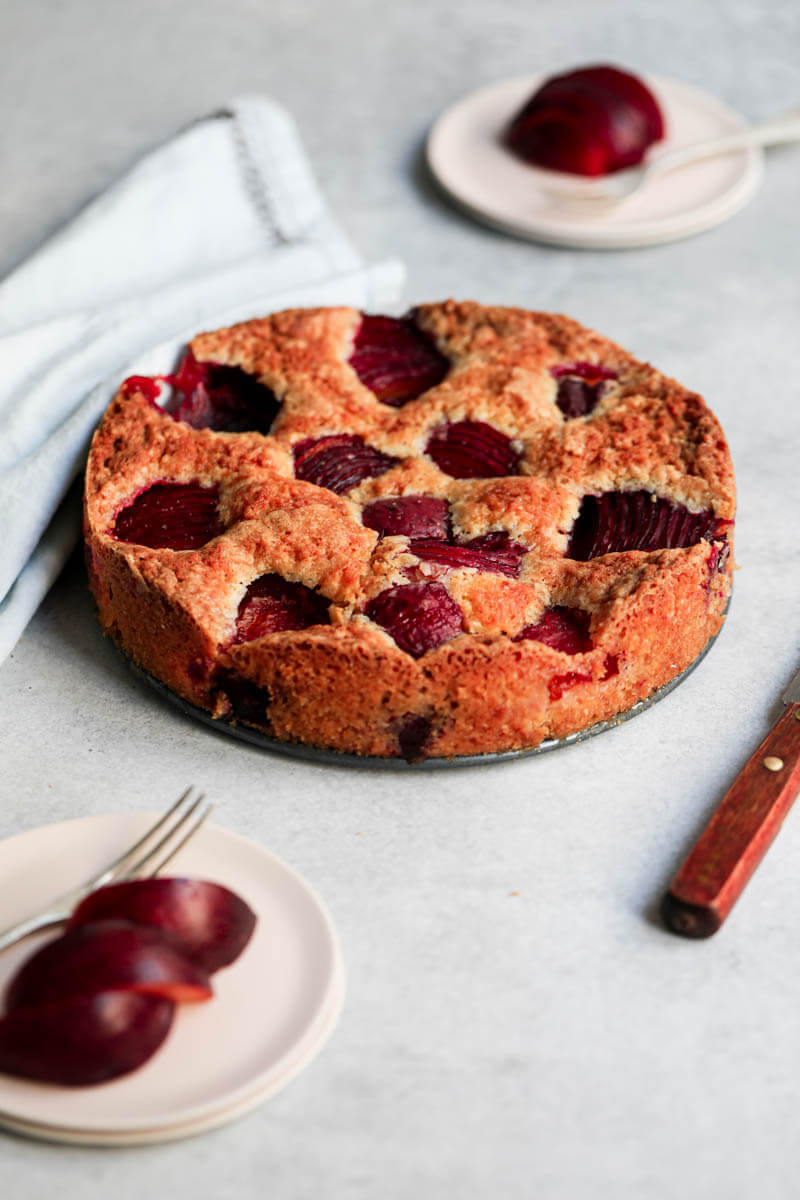 45° shot of a baked plum cake