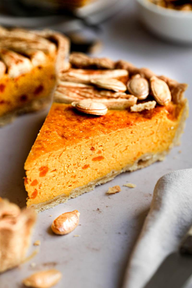 Closeup of one slice of pumpkin ricotta quiche.