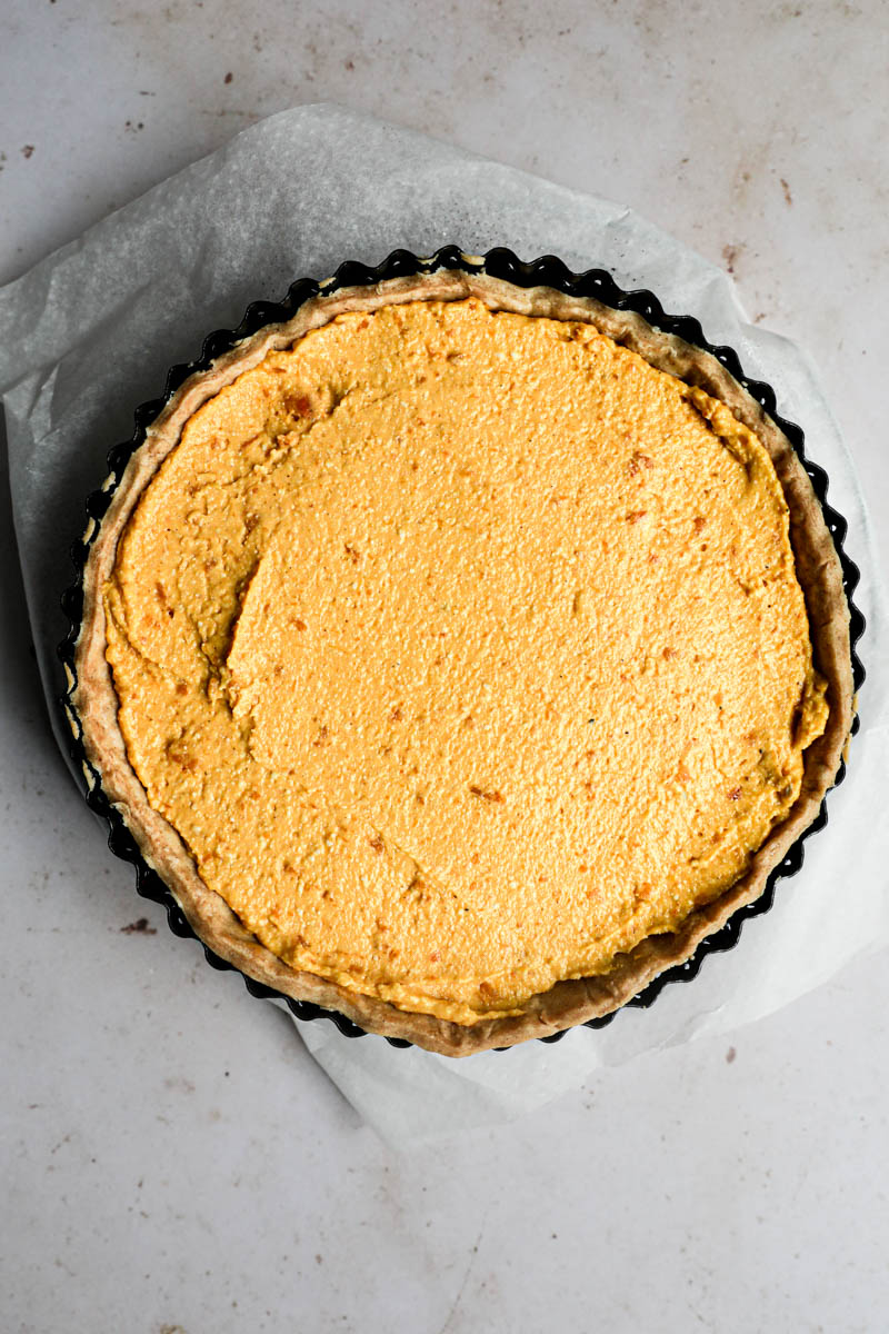 Baking the pumpkin quiche: The prebaked quiche crust filled with the fresh pumpkin filling.