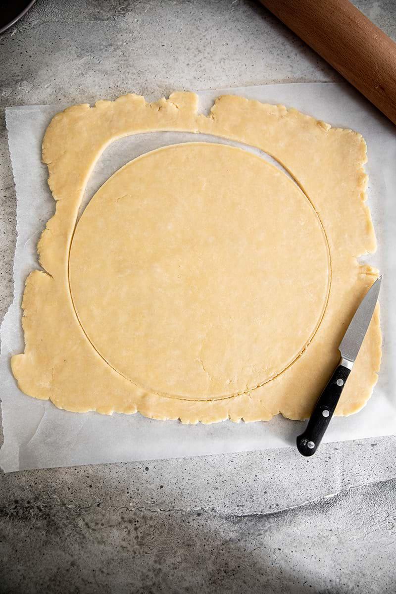 Cut out round of quiche crust dough
