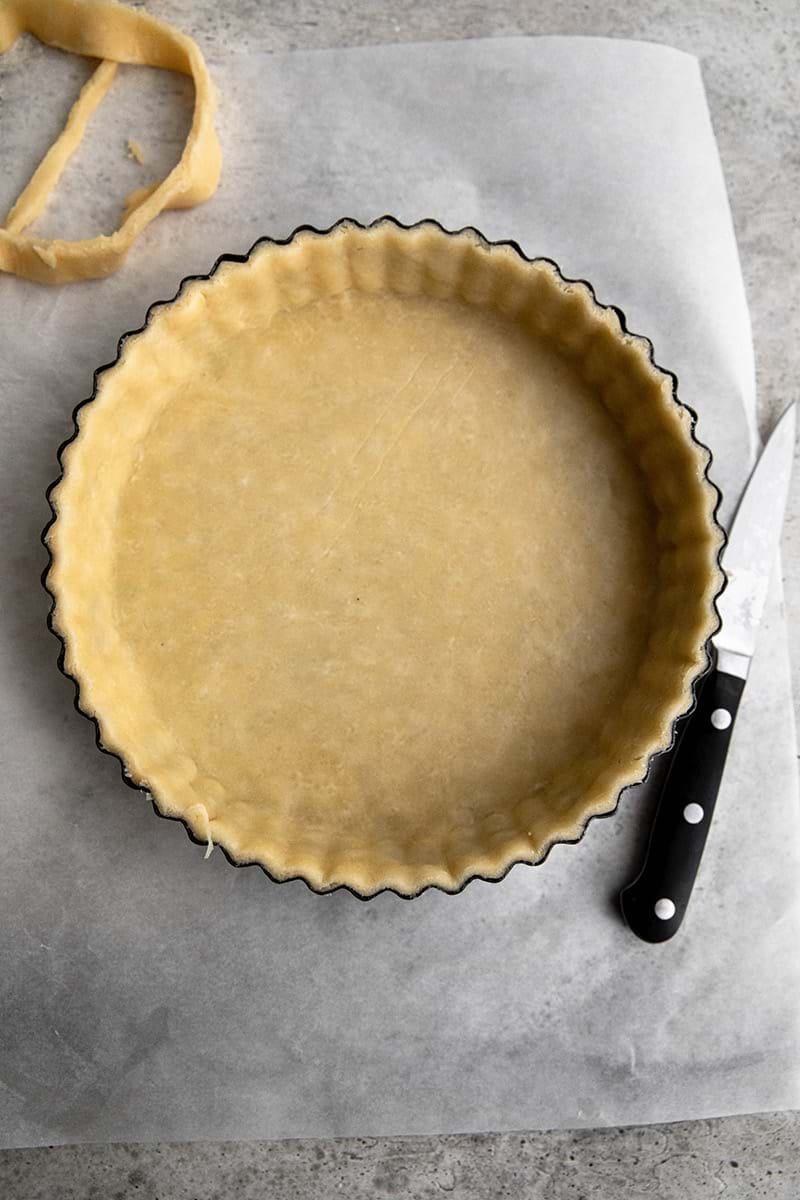 Tart tin lined with quiche crust