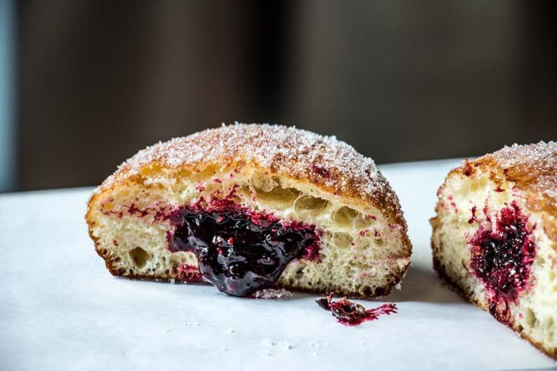 Closeup shot of one raspberry doughnut sliced