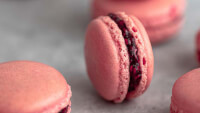 Raspberry macaron filled with homemade raspberry jam