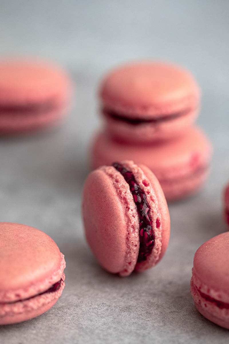 Raspberry macarons filled with homemade raspberry jam