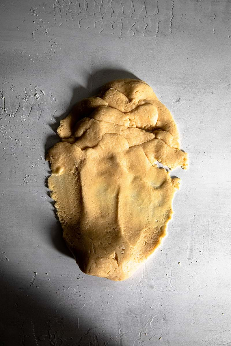 Smear the dough against the work surface