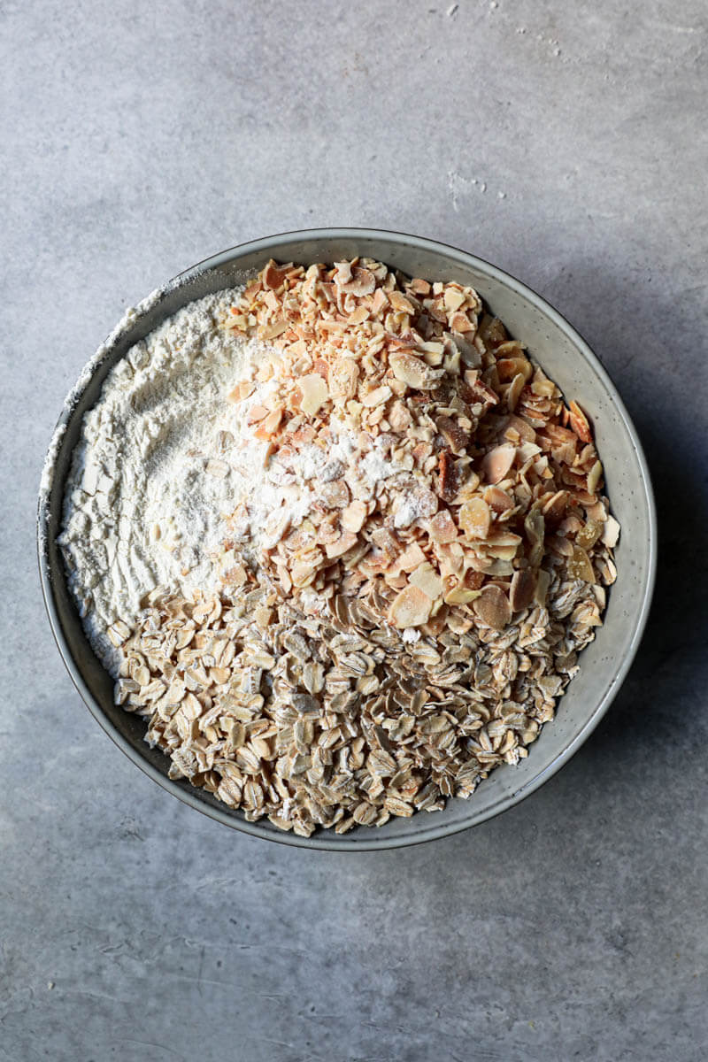 Dry ingredients in a bowl: almonds, oats, salt and flour